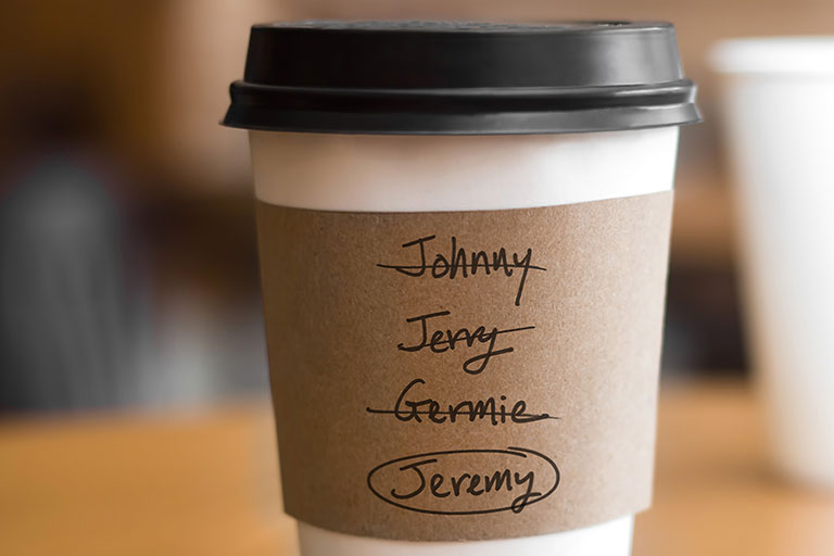 A coffee cup with several variations of Jeremy crossed out with the name Jeremy circled at the bottom.