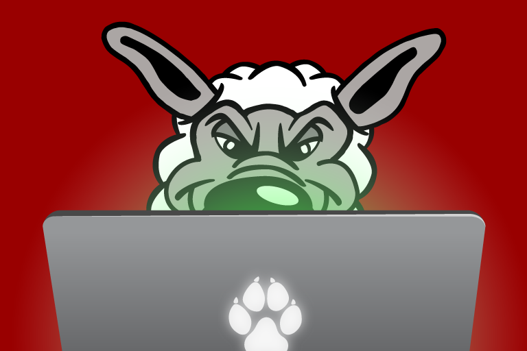 Cartoon image of a wolf in sheep's clothing in front of a laptop.