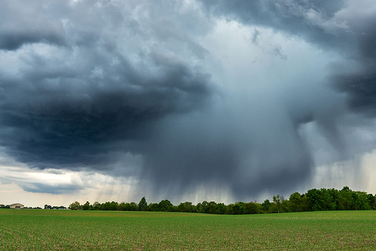 dramatic sky showing a microburst thunderstorm