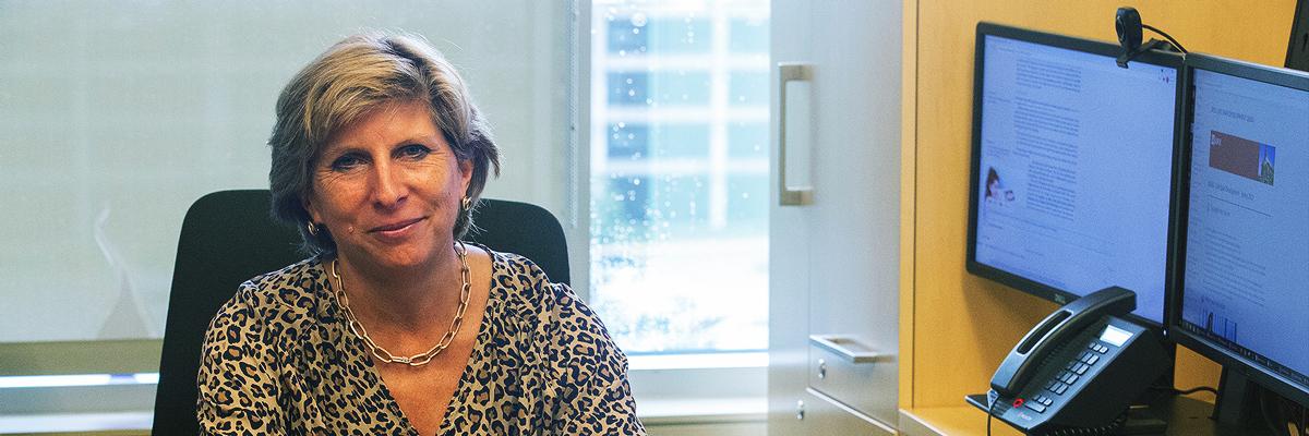 Kathy Johnson at her office desk